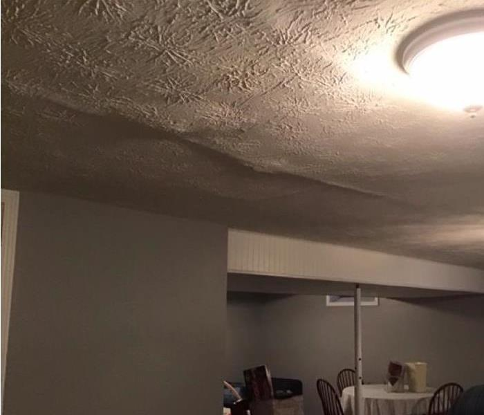 bubbling white ceiling due to water damage