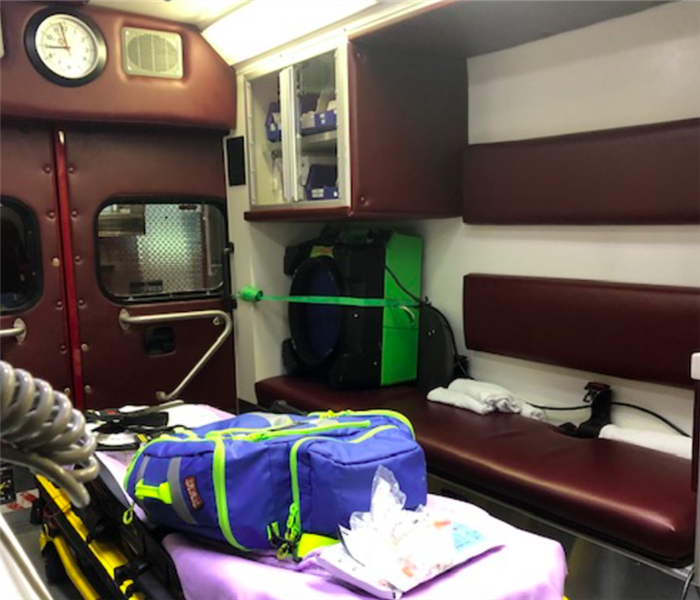 green hepa air scrubber in back of ambulance