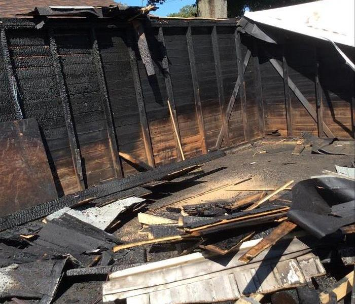 tearing down garage after fire loss