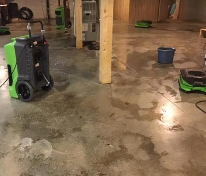 water on concrete floor with equipment set