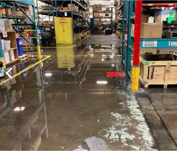water on brown warehouse floor