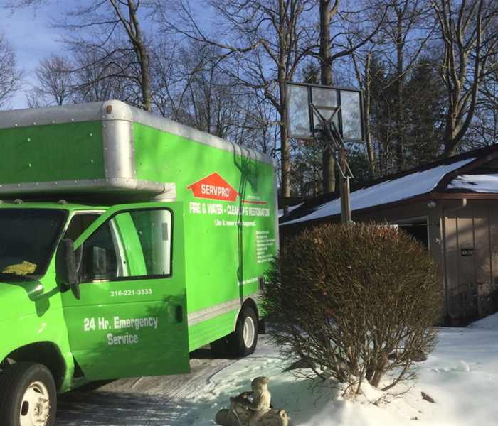 green van with door open outside of home